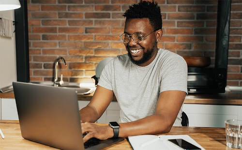Smiling person on laptop